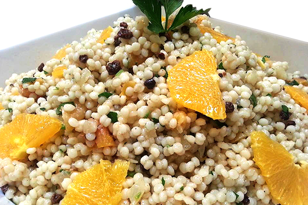 Moroccan pearl couscous with dried apricots, currants, caramelized onions, mint, scallions and pistachios.