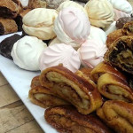 Assorted Russian sweets including Zefir marshmallows, poppy seed roulade and fruit strudel.