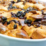 Challah bread pudding with dark chocolate, dried cherries, brandy and almonds.