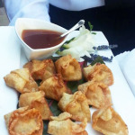 Goat cheese wontons with sun-dried tomatoes and chives.
