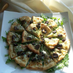 Pizza: fig, caramelized onion and gorgonzola cheese mushrooms and rosemary with Fontina cheese.
