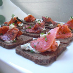 Smoked salmon on pumpernickel bread with chive cream cheese and crème fresh.