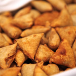 Indian samosas filled with potatoes, peas and onions served with tamarind chutney.