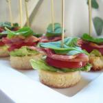 Mini gourmet BLT Bites on brioche with basil.