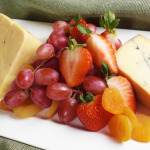 Selection of local and imported cheeses with seasonal fresh fruit, accompanied with crostini and crackers.