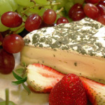 Selection of Local and Imported Cheeses with seasonal fresh fruit, accompanied with crostini and crackers