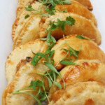 Vegetarian empanadas with sweet grilled corn, black beans, caramelized onions, ricotta and queso fresco.