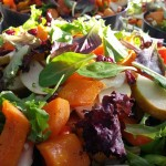 Field greens salad with caramelized pecans, permissions, pears, roasted butternut squash, dried cherries blue cheese and balsamic vinaigrette served on the side.