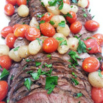Grilled Flat Iron Pichanga with charred cherry tomatoes and onions. Accompanied a Brazilian menu. 2