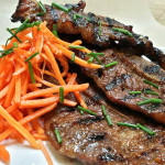 Korean barbecue beef short ribs with pickled mustard seeds and carrots. Accompanied a Korean menu.