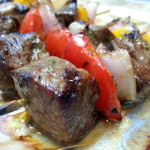 Marinated steak kebabs with charred red onion chutney. Accompanied a summertime barbecue lunch.