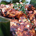 Pollo Adobado con Chirmol adobo chicken in fire roasted sauce. Accompanied a Guatemalan menu.