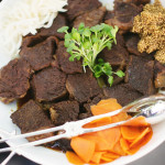 Slow braised short ribs in light soy sauce and Hoisin, pear juice, Mirin, sesame oil, with garlic, carrots and onions. Accompanied an Asian-fusion cuisine menu for a wedding.