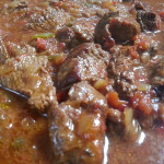 Steak Ranchero with onions, peppers, chilies, tomatoes and chipotle. Accompanied a Mexican menu.