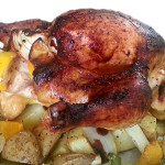 Roasted chicken stuffed with garlic, Meyer lemon and onion with barbecue glaze.