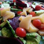 Ensalada Mixta - gold and red roast beets, heirloom cherry tomatoes, avocado, cucumbers in rocoto balsamic vinaigrette. Accompanied Peruvian menu.