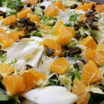 Frise and endive salad with oranges, fennel, fried capers with basil citrus vinaigrette and shaved parmesan cheese served on the side.