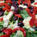 Mediterranean salad with artichoke hearts, roasted red peppers, marinated red onions, cucumbers, Kalamata olives in oregano vinaigrette. Accompanied a Turkish menu.