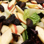 Mixed greens salad with dried figs and apples in balsamic vinaigrette.