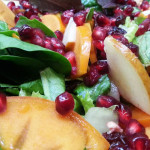 Mixed greens salad with persimmons, pears, pomegranate in apple cider vinaigrette. Accompanied a Thanksgiving lunch buffet.