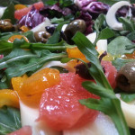 Mixed greens salad with pickled kumquats, grapefruit segments, mixed olives and hearts of palm in citrus vinaigrette.