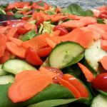 Mixed vegetable salad cucumbers, tomatoes, carrots, cilantro in lemon vinaigrette. Accompanied an Indian menu.