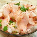 Pickled spicy daikon. Accompanied a Korean menu.