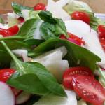 Romaine and spinach salad - jicama, cherry tomatoes, avocado, shaved radishes, queso fresco, pepitas in honey-lime vinaigrette.
