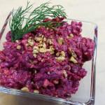 Shredded Russian beet salad with raisins, walnuts and garlic aioli. Accompanied a Ukrainian menu.