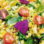 Summer corn salad with Sonoma greens, grilled corn and heirloom cherry tomatoes in basil vinaigrette.