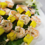 Fresh shrimp and mango skewers with sweet vanilla chili dressing. Photo by Andria Lo.