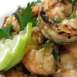 Fuente de camarones al aillo shrimp with garlicky Cuban mojo and tomatoes. Accompanied a Cuban menu.