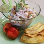 Red snapper leche de tigre ceviche with choclo, micro cilantro and red onions. Accompanied a Mexican menu.
