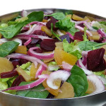 Spinach and Romaine salad with roasted beets, marinated onions, ricotta salata and creamy vinaigrette.