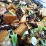 Chili and honey-glazed tofu and eggplant. Accompanied a Japanese menu.