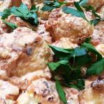Coliflor Envuelta en Huevo - egg-coated cauliflower with creamy tomato sauce.