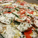 Creamy vegetarian gratin with grilled vegetables, roasted tomatoes, herb-infused cream, parmesan and gruyere cheeses.