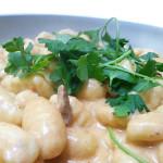 Gnocchi in creamy tomato-porcini sauce.