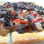 Vegetarian tarts with roasted mushrooms, peppers, caramelized onions, gruyere and Parmesan cheeses.
