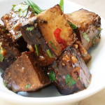 Vegetarian tofu with spicy ginger-sesame sauce with soy, sesame, scallions, ginger. Accompanied a Chinese menu.