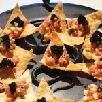 Spicy Tuna Tartare served on crispy wonton triangles.