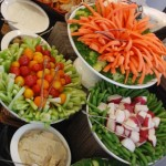 Vegetable crudités with fresh pita triangles and caramelized onion dipping sauces.