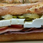 Ham sandwiches with brie, cornichons, apples, caramelized onions and dijon aioli.