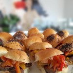 Flank steak sandwich on two-bite buns with red pepper relish.
